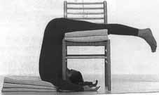 Ardha Halasana, with blankets and a chair